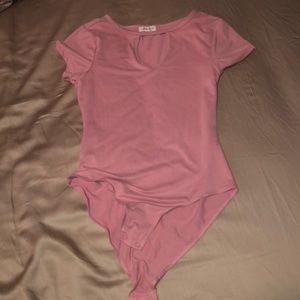 A pink bodysuit